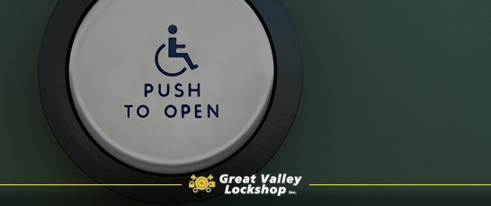Push-button door opener for handicap accessibility on commercial building.