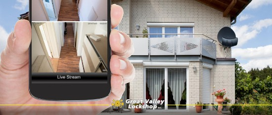 Homeowner looks at security cameras using a mobile app.