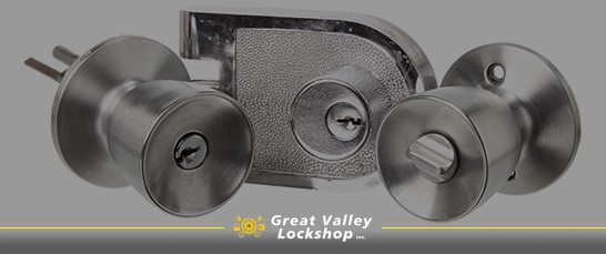 Selection of three new door locks and hardware for commercial use.