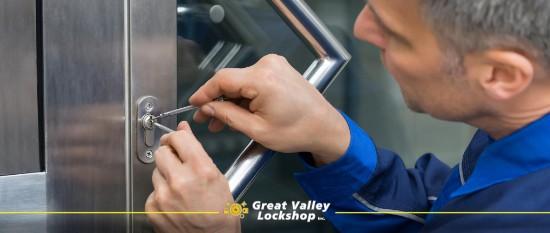 Locksmith works to unlock a door.