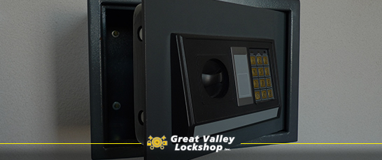 An open fire and burglary resistant safe installed in a wall.