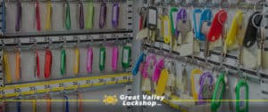 Many keys with colorful tabs hanging in a key management storage cabinet.