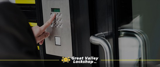 Man enters access code into a keypad lock.