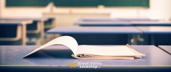 school book open on a desk in an empty classroom