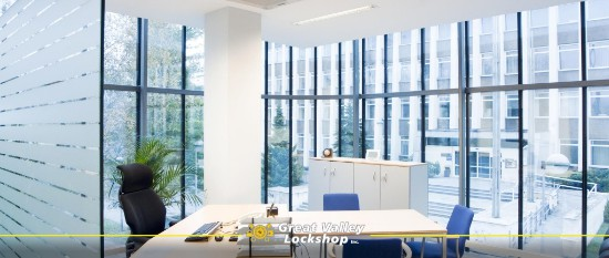 A modern office building that has smart tinted windows on the exterior and privacy film on interior glass.